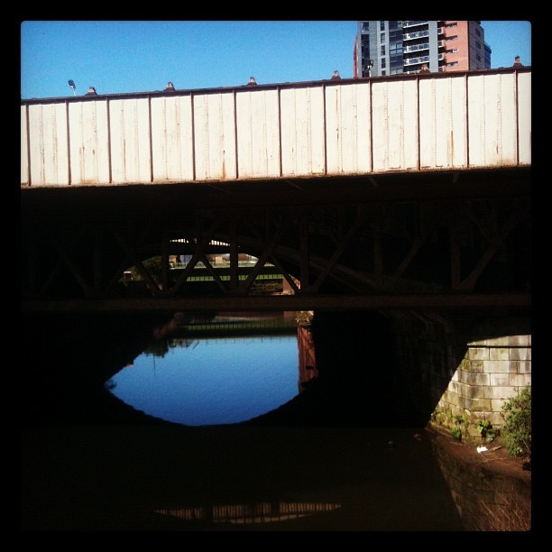 My #flat in the background, and the canal bridge below us. #home #manchester  (Taken with instagram)