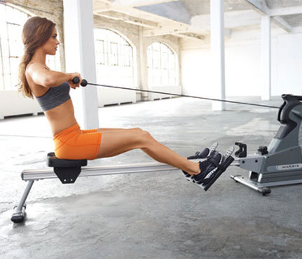 "Rowing—the Cardio Workout You Should Be Doing Why Rowing? Rowing is a full-body work out. It utilizes all your major muscle groups. It is a low impact exercise and thus can be used by people of all fitness levels. Rowing is used by many athletes in hopes to increase athletic performance because it improves aerobic fitness, increases strength, enhances coordination, and improves mobility. Rowing scorches calories and is great for weight management. A rowing machine, when used vigorously, can burn up to 125 calories in just 15 minutes. How do I row? 1. Grab the handle while sitting in an upright position, slightly leaning back with your legs straight. The handle should be pulled back so that it's just above your belly button. This is the ""finish"" position of a stroke.2. To start the next stroke, extend your arms, pivot forward slightly from the hips, and then bring your butt forward by bending your knees. This will move you towards the machine.3. With your arms still extended, you will reach the ""start"" position when your chest is a couple of inches from your knees.4. Start the next stroke by pushing back through your heels as hard as you can.5. Just before your legs are fully extended, pivot from your your hips to a slight lean and then pull your arms back so that the handle is just about your belly button.6. Transition as quickly as possible to your next stroke. Remember, each stroke starts with the legs, the back follows, then the arms. Legs, back, arms(Source: FitnessRX Mag, April 2012)Beginner Work Outs Row vigorously for 3-5 minutes, rest for 3 minutes by walking or stretching. Repeat four times. Row in 3 minute intervals with 1 minute rests. Try to increase your pace per interval. A More Challenging Work Out Row in 10-minute increments for a total for 4 times. Rest 3-5 minutes in between. Row for 20-minutes. Row 2 minutes high intensity and 1 minute recovery. Repeat throughout the 20 minutes. Remember: 18-22 strokes per minute is lower intensity, 30-34 strokes per minute is vigorous.  Sources:www.livestrong.comFitnessRX MagazinePhoto from: Fitnessmagazine.com"