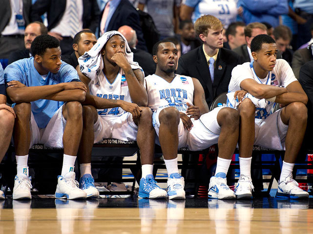 "Members of the North Carolina bench watch the final seconds of their season tick down during Sunday's 80-67 loss to Kansas. Kentucky, Louisville and Ohio State will join the Jayhawks in the Final Four. (David E Klutho/SI) MANDEL: Self's brilliant move helps Kansas stop UNCWINN: ""Russ-diculous"" rally saves LouisvilleSTAPLES: Kentucky enjoys smooth ride to Final FourGLOCKNER: Ohio State survives tumultuous season"