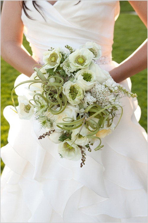 love the use of the massive air plants in this green and white bridal bouquet