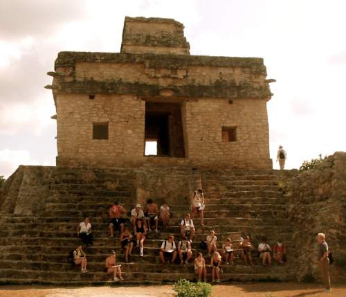 Students on the steps of the Mayan ruin site of Dzibilchaltan in Yucatan, Mexico.