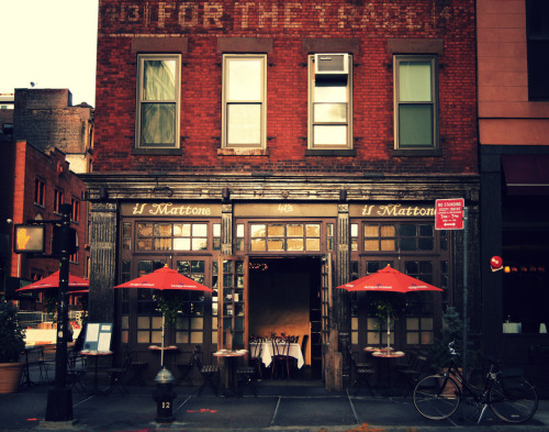 "nythroughthelens:  Corner restaurant on a sunlit evening. Tribeca, New York City. Certain colors dominate memory mixed on the palette of the mind's eye with the hues from dreams and tones of nostalgia. But it's the tones of nostalgia that stand out the most: the penetrating longing for places and moments we have or have not experienced that creates a void in our beings so deep that its echo is felt in every moment and heard in every thought. There are words for this type of nostalgia: sensucht and saudade. Sensucht is a German word that describes the emotional state of longing and yearning and saudade is a Galician- Portuguese word that describes a similar intense state of longing for something or someone. They can both be experienced as a longing for a place that is unidentifiable but somehow familiar and indicative of what we would most closely identify as home. Sometimes the yearning is so intense that only the emotional state is what we are aware of and it's not always easy to tell that there is a deep yearning for something or someone at that moment. New York City, for me, fills me with constant yearning with its colors and the way that light casts its glow on streets, brick, and the structures that fill in the image of New York City in my own mind. In the reds of the bricks I feel a longing for other cities I have not yet experienced and in the light that falls onto the street early in the evening I see the same light casting its glow on the spaces I wish to walk thousands of miles away. —- View this photo larger and on black on my Google Plus page —- Buy ""Saudade - The Colors of Nostalgia - Tribeca - New York City"" Prints here, email me, or ask for help."