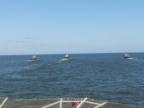 Tug boats pulling a Rig. Taken from the heli deck.