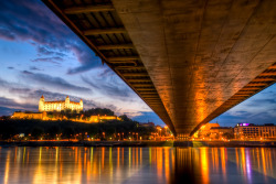 Bratislava Castle and the Danube in Bratislava Slovakia  Monumental castle known from the beginning of 10th century, built on former Slavonian fortification from 9th century from Great Moravian Empire above Danube river. Latest reconstruction is from 1956-1968. One of the city signatures. Location: N 48.142276, E 17.100043 Architecture styles seen in castle: romanesque, gothic, renaissance, baroque The castle stands on a hill where the earliest occupation dates back to the Neolithic period (5th millennium BC). The Castle was first time mentioned in Salzburg annals in 907 AD. Current appearance was built in 15th century AD (1427). The palace wing was built between 1431-34. Next reconstruction happened between 1552 - 1639 lead by Italian architects. The castle became coronation headquarters during the Tartar incursions from the east. The last big reconstruction was based on works of french, italian and austrian architects - J. N. Jadot, L. N. Pacassi and J. B. Martinelli in 1750-1760. In 1811 the castle was ruined by big fire and for 140 years remained damaged. The reconstruction started in 1953 restored its original appearance. photo via flickr