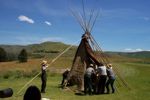 Nez Perce National Historical Park is a non-traditional National Park site. The park tells a story about a people that is spread over a large geographic area. For countless generations, the Nimiipuu or Nez Perce have lived among the rivers, canyons and prairies of the inland northwest. Despite the cataclysmic change of the past two centuries, the Nez Perce are still here.The park has thirty-eight sites in four states - Idaho, Oregon, Montana, and Washington. A park map is available here and can be used in conjunction with this list. Comprehensive trip planning information is also available here.In this photo, a 150-year-old buffalo hide tipi in the park's collection was photographed.  The tipi was probably made in the 1850s and consists of sixteen to twenty buffalo hides, stitched together with sinew. Photo: National Park Service