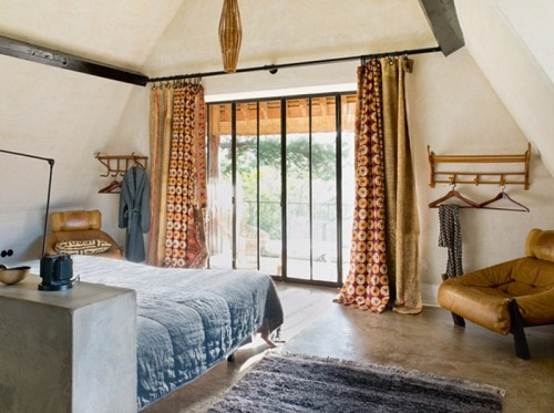 I love the idea of mixing drapes on a large window. Such a beautiful way to add interest, texture, and pattern to the space.
