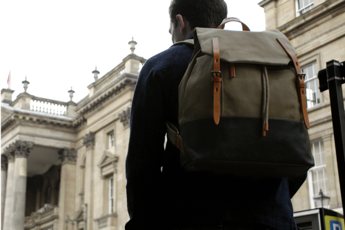 Ally Capellino - Dean Rucksack Originally starting life solely a womenswear label in 1980, Ally Capellino has grown into a brand that is synonymous with elegance and functionality, melding the two together to create pieces that are as welcome on Scarfell Pike as they are at St. Pancras International. The Dean Rucksack is constructed from sturdy cotton canvas with a coated base and thick bridle leather strap closure, the bag is hardwearing enough to withstand plenty of rough treatment and keep your belongings safe