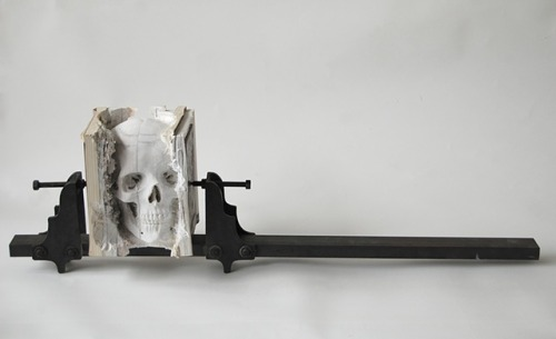 Maskull Lasserre - Incarnate (Three Degrees of Certainty II)  Skull carved out of old computer manuals