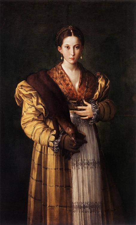 PARMIGIANINO (1503-1540) Portrait of a Young Lady c. 1535 Oil on canvas, 139 x 88 cm Museo Nazionale di Capodimonte, Naples  The lady is dressed in elegant clothes, with a yellow dress made of atlas silk. The top is patterned with lozenges, while from the hips down she is wearing a narrow white apron. Over her right shoulder, which curiously is far too broad, she is wearing a pine-marten fur stole complete with head.