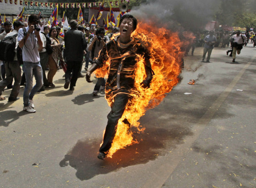 tpmmedia:  Picture Of The Day: Tibetan Protester Lights Himself On Fire Ahead Of Chinese President's Visit To India Jampa Yeshi (pictured above), a Tibetan exile, set himself on fire in New Delhi ahead of Chinese President Hu Jintao's visit to India, the New York Times reports:  The exile, Jampa Yeshi, who is believed to be 26 years old, set himself on fire at Jantar Mantar, the site of frequent protests, at 12:25 p.m., shortly after a Tibetan rally made its way back from Ramlila Maidan, another popular ground for political demonstrations in New Delhi. The protesters were agitating against the India visit of Hu Jintao, the Chinese president, for the BRICS Summit, an economic meeting of Brazil, Russia, India, China and South Africa, later this week.  Police and Tibetan activists doused Yeshi with water, and he was rushed to the hospital.     Our story: China is trying to crack down on self-immolations by Tibetan Buddhist protesters, but online videos are inspiring copy-cat deaths.