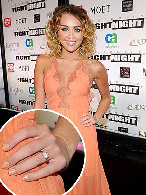 "Miley Cyrus & Liam Hemsworth: Engaged?  ""I am sooo obsessed with @jennahipp nail foundations!"" - Liam Hemsworth's girlfriend Miley Cyrus, in a Twitter posting meant to show off her manicure but sure couldn't disguise that ring on her left hand"
