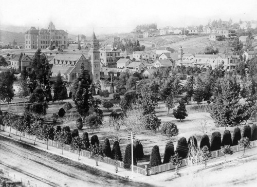usclibraries:  Circa 1885 view of Pershing Square, then known as the Lower Plaza, in downtown Los Angeles. In the top left, the State Normal School stands on Normal Hill at the present-day site of the Los Angeles Central Library.
