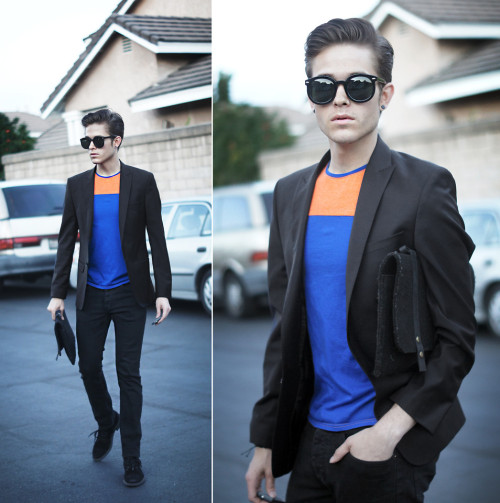 lookbookdotnu:  Dark & Dynamic  (by Adam Gallagher)  Are most men where you are wearing that same boring suit? With the same boring shirt underneath? Make things interesting with a bright, color-blocked shirt under your jacket. This is a way to be unique without going over the top :)