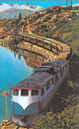 White Pass & Yukon Route postcard showing two GE Class 90s hauling a passenger train. Blue paint scheme. Circa 1970's. Credit: Benjamin Schlechter