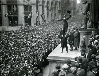 maximalist-theme:  Douglas Fairbanks boosting Charlie Chaplin to promote the Liberty Loan at a Wall Street Rally. New York, 1918.  Chaplin even made a short film to help sell bonds for World War I. Decades later, U.S. officials labeled him un-American, and he was forced into exile.