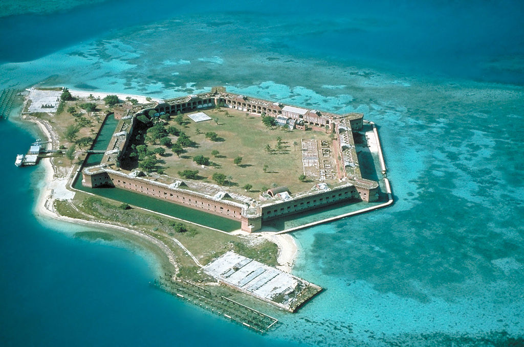 Fort Jefferson, Florida, is an unfinished fortress in the Florida Keys. It contains 16 million bricks, making it the largest masonry structure in the Western Hemisphere.  And, it's a ghost town — it's been unused since the late 1800s. (Photo via Wikimedia Commons)