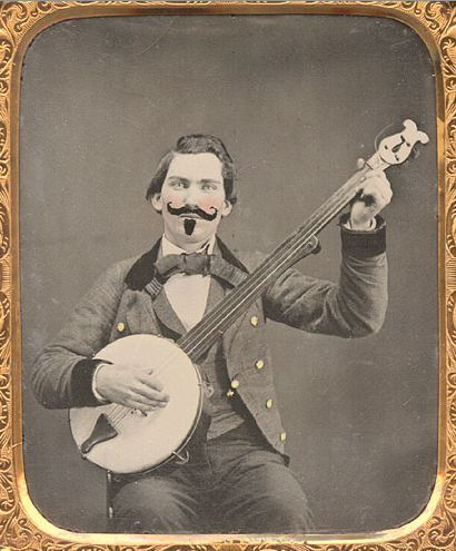"ca. 1860, [ambrotype portrait of a gentleman strumming a banjo, with applied hand-coloring and a finely etched false ""imperial"" goatee and mustache] via Christopher Wahren Fine Photographs"
