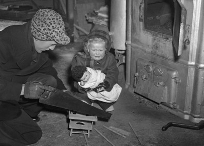 During the coal strike of 1950, a father is forced to use his daughter's toy high chair as fuel to warm the home, Chicago.