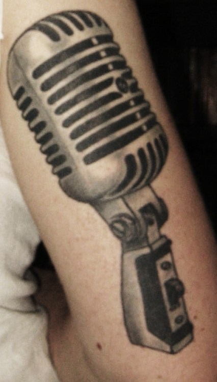 "My latest tattoo, Shure Unidyne 55SH. Got this in 2009, tribute to Jimmy Gnecco and Jeff Buckley. Jimmy has a similar microphone tattoo on the front of his left arm, and mine is on my back right arm and the microphone from Jeff Buckley's ""Grace"" album cover. Ink by Nick Fabini of Cardinal Tattoo Ft. Wayne Indiana http://nickfabini.blogspot.com/"