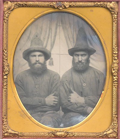 ca. 1860-1880, [ambrotype portrait two heavily bearded gentlemen in pajama-like costumes and elongated cone hats, possibly clowns] via Christopher Wahren Fine Photographs