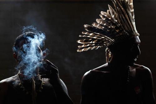 politics-war:  An indigenous man smokes at the national congress in a protest against two proposed constitutional amendments (PEC) presented by parliamentarians that alter the demarcation process for indigenous lands.