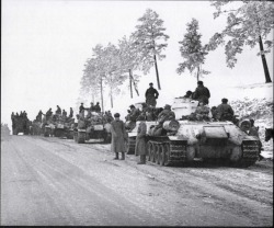 historicaldetailsandstuff:  A column of T-34 tanks waits to move up to the front in the winter of 1943/44.