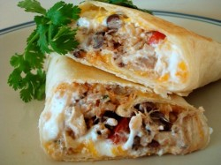 Crispy Southwest Chicken Wraps *Makes 6 wraps* INGREDIENTS:1 cup cooked rice, warm or at room temperature1 cup cooked, shredded chicken1 can black beans, rinsed and drained1 green onion, finely sliced (white and green parts)1/2 red or green pepper, diced1/4 cup fresh cilantro, choppedjuice of 1 lime1/2 tablespoon chili powder1 teaspoon ground cumin1/2 teaspoon garlic salt2 cups shredded cheese (I used a combination of monterey jack and sharp cheddar)Sour cream (optional) 6 burrito-sized flour tortillas DIRECTIONS:Mix rice together with chili powder, cumin and garlic salt. Add remaining ingredients except for cheese and sour cream. Sprinkle cheese over tortillas, leaving 1/2-inch border around edges, then arrange chicken and rice mixture down the center of each tortilla. (Optional: on some of the wraps, I dotted the cheese with about 1-2 tablespoons of reduced fat sour cream before arranging chicken and rice mixture down the center – it made the wraps delightfully creamy.) Roll stuffed tortillas, leaving edges open. Spray the tortillas all over with cooking spray. Heat a large non-stick skillet (or griddle) over medium heat for 1 minute. Arrange 2 wraps, seam-side down, in pan and cook until golden brown and crisp, about 2-3 minutes per side. Transfer to a plate and repeat with remaining wraps. Serve. www.melskitchencafe.com