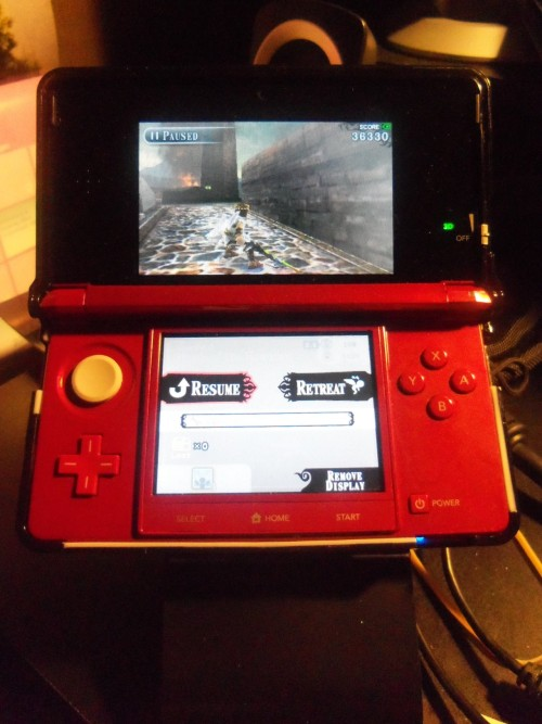 thecompanioncube:  tsukiomi:  Plus it came with a 3Ds Stand as well. Thank You Nintendo!!!!  The need for this proves the system was poorly designed. It kind of defeats the purpose of playing a hand held if you have to play it at a table…   You don't need it, actually. -___- The handheld stand is more for comfort if you're at a desk or whatever, not necessarily for the 3D.I play the 3DS all the time with absolutely no need of a specific stand or to hold it in a really picky position. The 3D is pretty good, imo. It was rough when they first introduced the 3DS at game shows and the like, but as long as I'm not holding the 3DS like a dumbass, the 3D is fine.I just can't play with 3D too much because it gives me a headache. I can barely make it through a 3D movie without feeling sick.Poorly designed? Not really. I'd rather it the way it is than have to sit with a pair of special glasses or whatever.