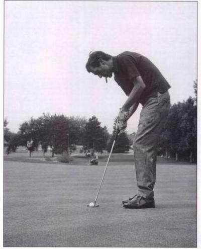 Chet Atkins on the putting green.