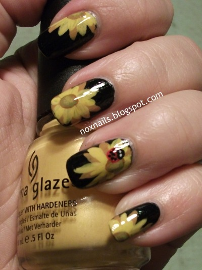 noxnails:  Spring manicure of sunflowers and ladybugs.  Better photo than last time.