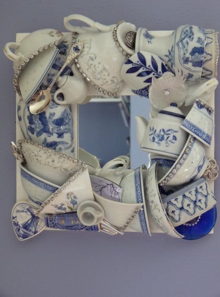 truebluemeandyou:  DIY Inspiration: Teacup Mirror. If you go to her site and look at the other photos of this mirror, you'll see how artfully everything is arranged. More photos from Beyond the Fringe Crafts here.