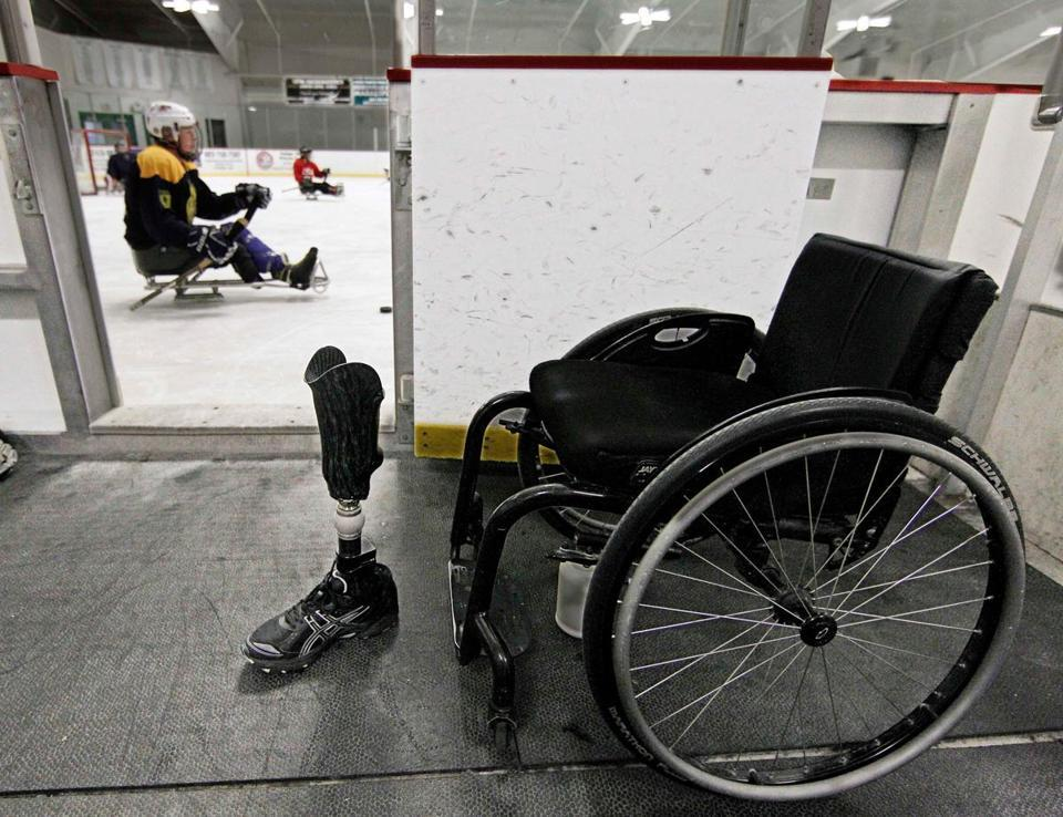 Disabled veterans hit ice with passion on display  - Sled hockey has become popular with wounded veterans of Iraq and Afghanistan, requiring them to think, react, and move in new ways.