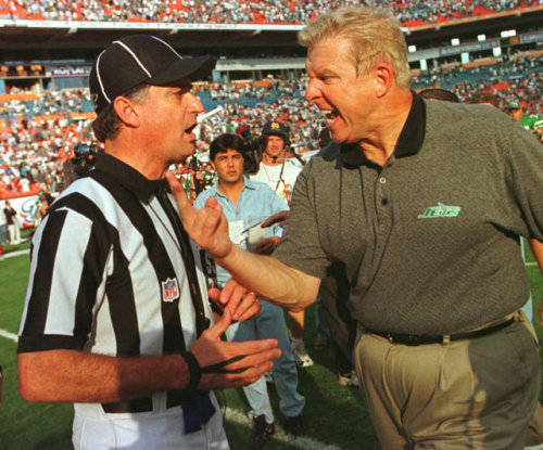 siphotos:  Jets head coach Bill Parcells complains to side judge Mike Pereira at the conclusion of a 1997 game against the Dolphins. The coach was arguing a call late in the fourth quarter that was ruled as an incomplete pass to wide receiver Wayne Chrebet. Parcells is rumored to be taking over as Saints head coach for the season while Sean Payton serves his suspension. According to SI's Peter King, however, Parcells is unlikely to take the position. (AP Photo/Hans Deryk) KING: Odds against Parcells coaching Saints, but many factors at playGALLERY: Classic Photos of Bill Parcells