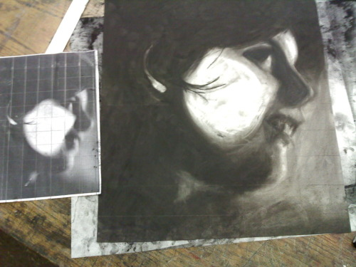 in my art class last semester we had to xerox our faces and then draw it with charcoal here's the result