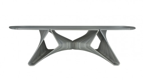 "Endless Flow saloon table by Dirk Vander Kooij Vander kooji used an old industrial robot and reprogrammed it in such a way that it could ""print"" furniture. In a virtually perpetual movement the robot extrudes recycled refrigerator interiors into chairs or any other kind of furniture."