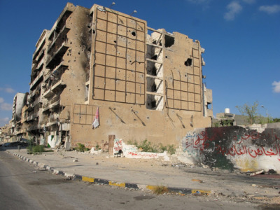 Libya: A Precarious Situation for Vulnerable Populations  As Libya grapples with consolidating state authority and restoring normality after the revolution, groups of migrants, refugees, and internally displaced people remain in a vulnerable and precarious situation. MSF is continuing to provide basic medical and psychological assistance to these groups in Tripoli. In parallel, MSF will also end its remaining activities in Misrata at the beginning of April to refocus on other areas of intervention.  There are concerns that camps in Tripoli are being shut down by authorities without any clear strategy that the people will be appropriately cared for afterwards, leaving former residents in an even more vulnerable situation. Already on February 14, a camp where hundreds of primarily sub-Saharan African migrants had taken refuge was closed and evacuated. On March 20, another camp housing approximately 300 Somali refugees was evacuated, with residents now being spread out over Tripoli. As MSF had been running mobile clinics in these two camps, it is now trying to trace patients to be able to ensure the provision of follow-up care if needed.  Currently, MSF is running mobile clinics in two camps for internally displaced people in the city, providing basic health care and psychological support. When necessary, MSF also assists in referring residents to secondary health structures. The camps, containing a total of approximately 4,000 people, are primarily made up of people from the Tawargha city. Members of this community were forcibly displaced at the end of the conflict, and are unable to return home. On average, MSF performs 50 consultations in these two camps every week.Libya 2011 © Niklas Bergstrand Nearly all buildings in Tripoli street in downtown Misrata were completely destroyed during the war.