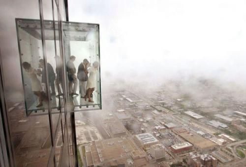 A clear glass elevator that transports you to a really  height floor,where you feel as if you were in danger of a free fall with no stops.