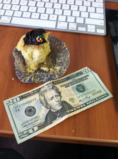 moneyfood:  A $20 bill and a half eaten office cupcake.  Hello world, I just started a new Tumblr: MONEYFOOD. Its Food. And Money.