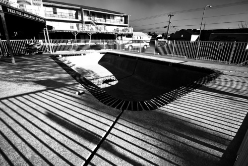 Winter Pool Took this photo a few weeks ago in Seaside Heights, NJ.  When I took the image I knew I wanted it to be a black and white and focus on having a strong contrast between the shadows and the light.  It came out interesting as a black and white because even though it was bright out, the sky had a strong overcast which made it look like dark storm clouds in this picture.