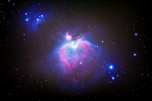 "M42- The Orion Nebula by Sean Parker The Great Orion Nebula, also known as M42 or NGC 1976, located near the middle of the ""sword"" hanging from Orion's ""belt"" of stars. It is about 1,000 light-years distant and as many as 60 light-years in diameter. The nebula is an enormous cloud of gas surrounding a cluster of very hot young stars. To the naked eye the nebula appears to be a faint star but becomes a vague patch of light when viewed through binoculars. The bright region is divided into two sections, the northeast portion being cataloged separately as M43 or NGC 1982. The Orion Nebula is the nearest major site to earth of massive star formation."
