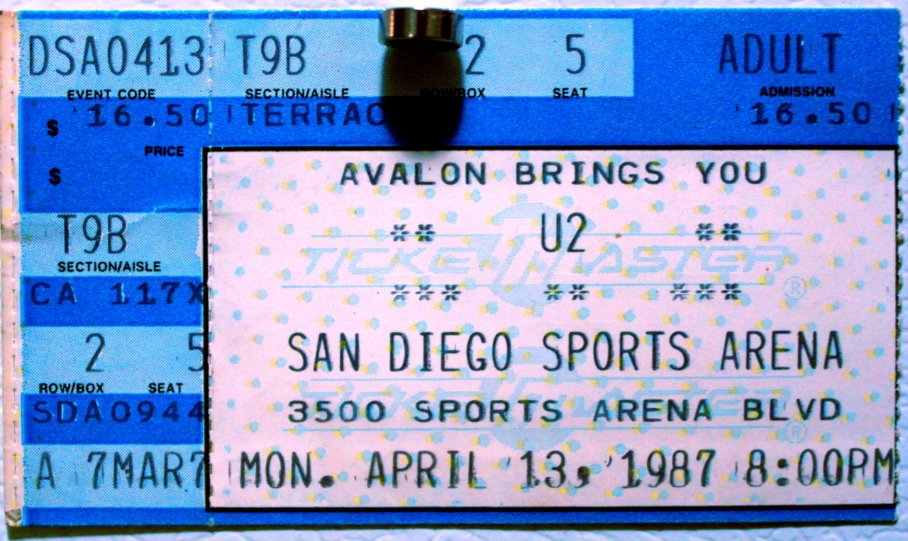 "SONGS OF INNOCENCE AND EXPERIENCE feat. U2 &  MURPHY'S LAW SAN DIEGO 1987 I've been a serious and dedicated fan, producer, and observer of music, art, and culture now for about 35 years. That's long enough to have seen some stuff. I've watched trends, styles, fads and fashions come and go the same way anyone who pays attention to this sort of thing long enough would see. I've also seen great styles, art, and music stick around, mutate, and grow in meaning and historical importance both on a personal experiential level and in the broader culture more generally. Sometimes I agree with the prevailing tastes and fascinations, more often than not I don't. Just like anyone else might. It occurred to me the other day that in a lifetime of working as a creative-type and of closely observing the creative output of others, one naturally moves as I have myself (to borrow a phrase from my all-time hero, William Blake) between singing Songs of Innocence and Experience. I'll explain what I mean by this. In an earlier post I talked about the profound impact the murder of John Lennon had on me and how that tragic event paved the way for my immersion in the punk scene of the early 80's. Well, by 1987 I had been thoroughly immersed. I'd moved from the Pacific Northwest to Southern California, I'd seen every punk show I could along the way, I had toured the entire country as the roadie for one of the top punk/hardcore/indy groups of the time the great 7 SECONDS. I'd done a fanzine, put on shows, and was playing guitar myself by this point. If I'd been any more immersed in the scene I would have drowned. I'd collected flyers, records, zines and a lot of really good friends but more than anything I'd gathered my first real body of experience. I was no longer the wide-eyed kid hanging out on University Avenue in Seattle trying to look cool. I was now the ""older, wiser"" kid in my late teens. I've never been closed minded about anything really but as far as my musical taste went the first half of the 80's was pretty much all about the punk. I liked the good bands, I liked the mediocre bands and I liked the sh-tty bands. My friends and I would think nothing of driving 2-5 hours to see shows in far flung, unglamorous corners of LA county, places like Pomona, SunValley, or Oxnard. We'd drive to San Francisco and back on a weekend to see some bands we didn't even particularly like just so we could hang out and meet up with people.  By 1987 Fender's Ballroom in Long Beach was the most dependable and frequent L.A. show locale. Conveniently located in South L.A., it was a relatively short hop up I-5 from San Diego so getting up there was no big deal. The shows were usually 4-7 bands to a  bill so there was never a reason not to go and go we did. The scene at Fender's was not a pretty one. The place itself was ugly, the sound was at best not so great, the crowds were a swollen collection of spiky Brit-style L.A. fashion punks, hardcore kids, nazi skinheads from O.C., Samoan Crips, tough guys, thrash metallers, late-comers, curious high school kids, and my friends and me (of course we defied categorization). For some reason there weren't a lot of girls…surprising huh?. I saw some great bands, a lot more crappy bands and I witnessed and narrowly avoided getting caught up in countless fights and acts of average to extreme violence there. Just to give this part of the story some color: I once saw a dude get carried out of the pit after a huge fight, knocked out, covered in blood, with his eyeball popped out of its socket. Gulp. Gulp. Hurl. Hurl. If I listed all the bands I saw at Fender's this post would be twice as long as it is so I'll spare you the roll call and instead tell you about the last night I went to Fender's. Back in the pre-internet punk days you learned about shows two ways: by word of mouth and by flyers. Like a chain, you'd go to a show one weekend and you'd see flyers for next weekend's shows. If you missed a weekend your friends would let you know what was happening. It was a simple, elegant system. One weekend at Fender's I learned that Murphy's Law from N.Y.C. would be playing a rare Sunday night show at the venue as an add-on date after their show the night before opening for The Beastie Boys at some big rock place. A rumor was circulating that the Beasties would also be stopping by that night to do an unannounced set.  This was not to be missed. The Beasties were HUGE and anyhow I'd dug them since their first hardcore 7"" and their current mega-hit L.P. Licensed to Ill was as great as anything that'd come before from them. Plus it'd just be cool to be in on such a thing. I was there.  To make a long story short, we went up the next weekend. The Beasties didn't show. The place was half-full, there were tons of fights, tons of nazi skinheads, the bands sucked, the place sucked, and we had to be at school the next morning. On the way back down the coast as my friends and I talked about the ugliness and stupidity we'd witnessed that night and how it wasn't any different from so many other shows we'd seen before, just a little dumber and more brutal than usual was all, a realization so obvious, yet stunningly new occurred to me and I thought to myself: I don't ever have to go to another punk show again if I don't want to! The ticket stub pictured above is from a U2 concert I went to at the San Diego Sports Arena in 1987 sometime after the ill-fated Murphy's Law show. I don't know exactly how long after. I do know this however: I loved this concert! On the surface it was everything I and punk stood against: big arena rock (my first arena rock show in fact), expensive tickets ($16.50!?), a super-popular band everyone liked, rockstars on stage, assigned seats, etc. etc. None of these disqualifiers however changed the fact that the crowd was elated, the songs were expansive and positive sounding, there was emotion present, there was passion, there were GIRLS in the audience! Lots and lots of girls and women and parents and kids and everyone including me was having a great time.  Innocence regained. It wasn't until a few years later when I encountered Riot Grrl, Grunge, and the Pop Underground that the word ""punk"" left anything but a sour taste in my mouth. Though to be sure, there were always underground bands making great, original, soulful music before, during, and after my love affair with the hardcore scene tanked. One band above all in that period held my and many other people's interest like no other: a little group from Washington D.C. called Fugazi. More about them later. U2 ticket stub from my personal archive."