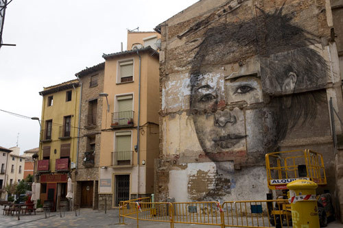 Big ol' charcoal street art by Jorge Rodriguez-Gerada.