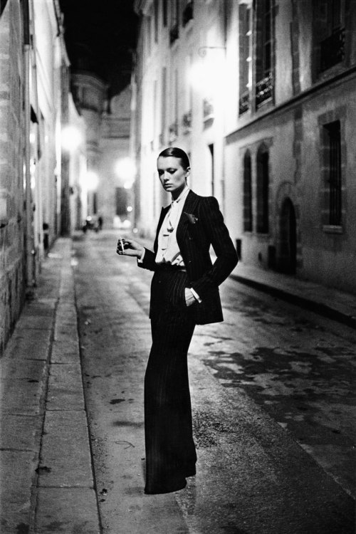 toryburch:  H is for Helmut Newton. Photograph by Helmut Newton, 1975. Image courtesy of The Grand Palais and Helmut Newton Estate. Stylish and provocative — Yves Saint Laurent's famous gender-bending suit