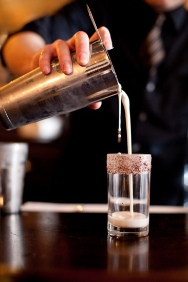 "Casey Makes a Brandy Milk Punch - We Get Drunk and Happy Edible Brooklyn's new issue is all about dairy.  In it, there's a killer piece on our brandy milk punch.  Here's a snippet:  Loosely based on chef/owner Cal Elliott's favorite dessert, a Brandy Alexander pie, the Brandy Milk Punch is made with Ronnybrook whole milk, Jacques Cardin brandy and house-made Demerara syrup. The final touch is the glass rim: moistened with an orange slice and dipped in cocoa nibs from Brooklyn bean boys, the Mast Brothers. After a vigorous, even violent, shaking with ice… the cocktail is strained into a glass and transformed into a light, fluffy concoction. ""You see it, and it looks like it's going to be thick,"" [Casey] Van Heel warns, ""but it's not.""   The entire dairy issue is awesome - we love Edible.  To check the article and the issue out, go HERE."