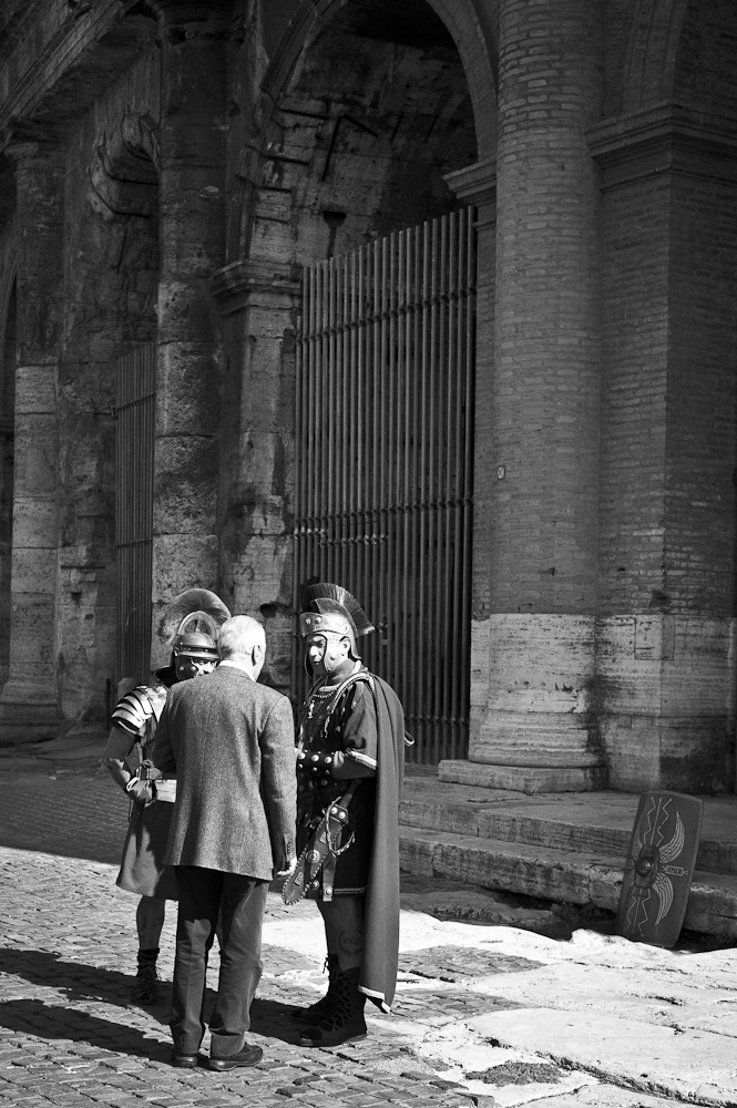 Maybe he asked them where to get those costumes. Colosseum, Rome, Italy. March 2012