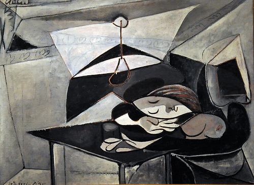 "Pablo Picasso's ""Woman Asleep at a Table""(1936)   In autumn 1936 Picasso moved his lover Marie-Thérèse Walter and their year-old daughter, Maya, to a country house outside Paris, near Fontainebleau, belonging to the art dealer Ambroise Vollard. Although Picasso frequently depicted Marie-Thérèse asleep, this work may also reflect the sweet exhaustion of the new mother-as well as the perplexity of the fifty-five-year-old father: when Picasso painted this canvas, he had already met Dora Maar, his new lover. One year later, Picasso would use the same restricted palette for the large mural ""Guernica"""