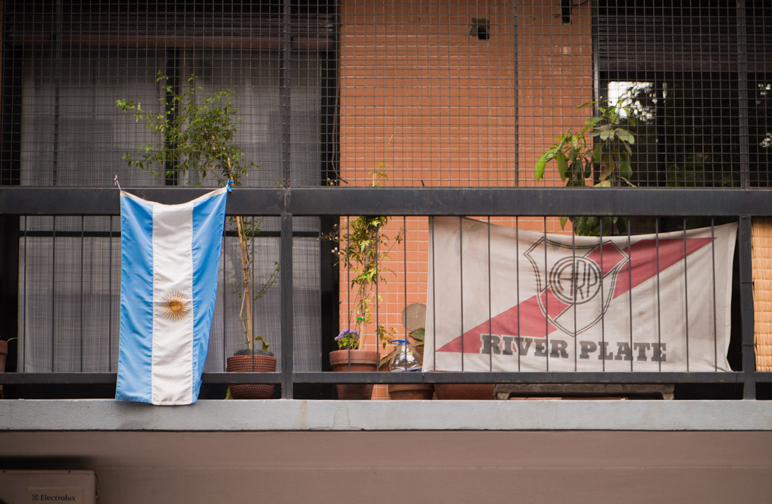 River Plate and Argentina's flags on a Buenos Aires balcony