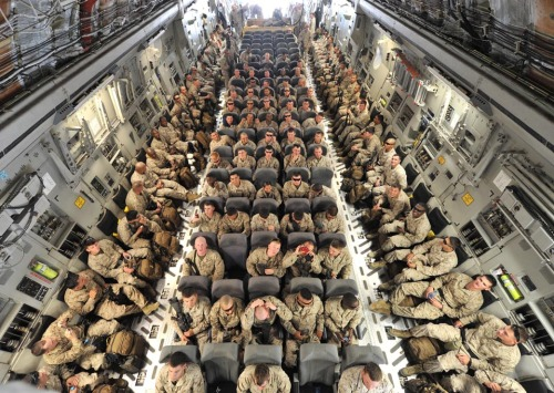 WSJ: American servicemembers waited inside a transport plane for their departure to Afghanistan from a transit center near Bishkek, Kyrgyzstan, Tuesday. photo credit:  Vyacheslav Oseledko / AFP / Getty Images (via WSJ)