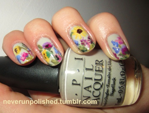 Spring Floral NailsTook a little bit of inspiration from below, the gorgeous weather we're having here in the UK, plus a few too many nail polishes to get this! I painted my left hand yesterday, sorry about the tip wear. Base colour is OPI Skull And Glossbones, which I have been loving recently. I've tagged all the brands I used, contact me if you'd like to know a particular shade. ((Inspiration Source))