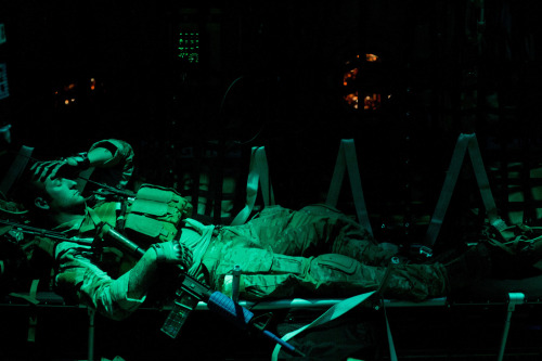 A Green Beret rests on a C-130J Super Hercules during Emerald Warrior 2012. (3 March 2012)